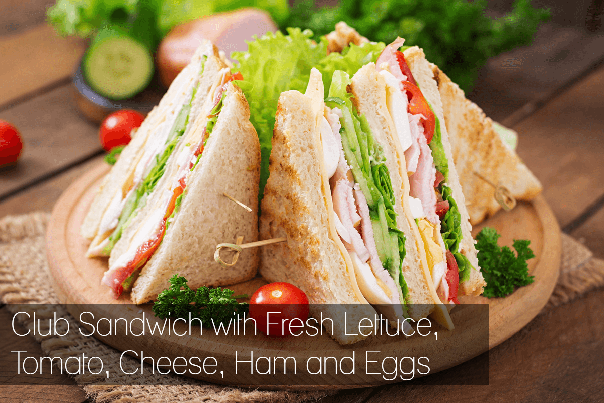 Club Sandwich with Fresh Lettuce, Tomato, Chesse, Ham and Eggs